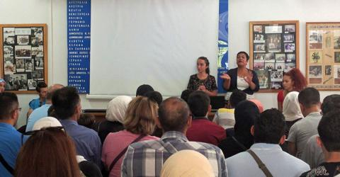 IOM staff conducts pre-departure orientation for asylum seekers before they leave for France. Photo: IOM
