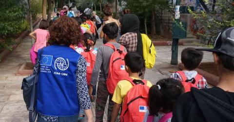Refugee children leave for their first day at a Greek school. Photo: IOM