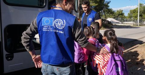 IOM buses migrant and refugee children to Greek schools. Photo: IOM