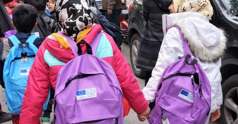 Refugee and migrant children on their way to school in Greece. Photo: IOM