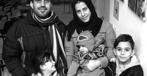 Suleiman, Roula, Moulham, Kinana and baby Mohammad.  Roula (left, back row) a hairdresser, relocated with her family from Greece to Portugal in February 2017. Photo: IOM 2017