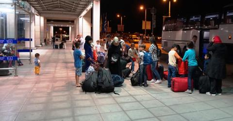 Families and unaccompanied child migrants leave Greece to travel to Finland. Photo: IOM