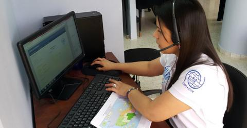 A Honduran call center operator advises migrants on legal and other issues.