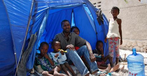 Saint Soi and his family at the Fond Bayard school in Fond Parisien near the Malpasse border after returning from the Dominican Republic. © IOM/Ilaria Lanzoni 2015