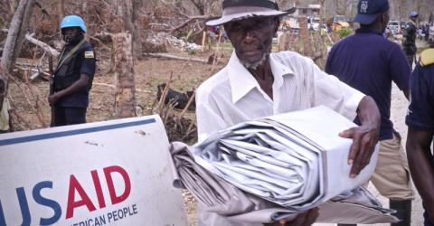 An old man receives NFIs provided by USAID and distributed by IOM Haiti in Jeremie. Photo: Hajer Naili / IOM.