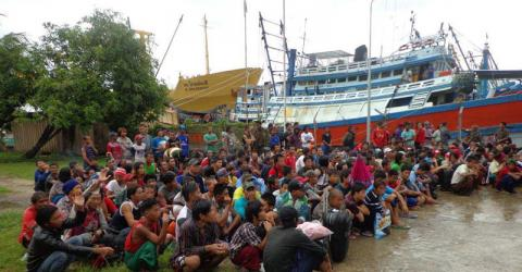 A first group of slave fishermen prepare to leave Benjina island in Indonesia last week.