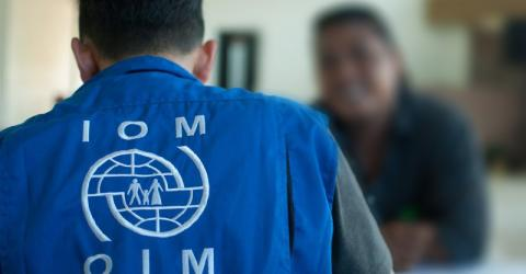 IOM staff interviews Myanmar victims of trafficking in Ambon, Indonesia. © IOM/Ario Ap 2015