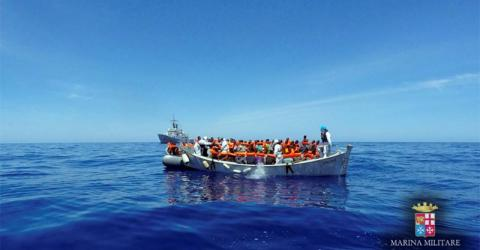 A rescue operation by the Italian navy ship Grecale (unseen) off the coast of Sicily, Italy. Photo: Marina Militare, May 6, 2016