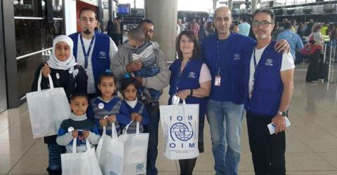 Ahmad and his family and IOM staff at Queen Alia International airport in Amman. Photo: IOM 2016