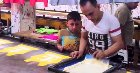 Mohammad al-Aswad, the protagonist of Why Not, demonstrating the process of printing on shirts in his print shop in Tartous. @ IOM