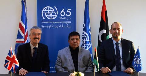 UK, Libyan and IOM representatives sign the agreement. Photo: IOM