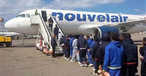 Nigerian migrants boarding a plane in Libya. Photo: IOM