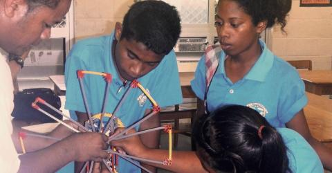 Marshallese students learn about the mechanics of wind turbines under the IOM CADRE programme.