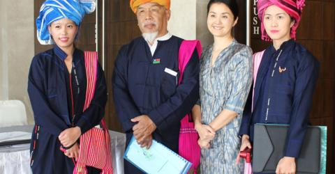 Members of the Parami Development Network and IOM's Michiko Ito (second from right) at the Twe Let launch in Myanmar. Photo: IOM