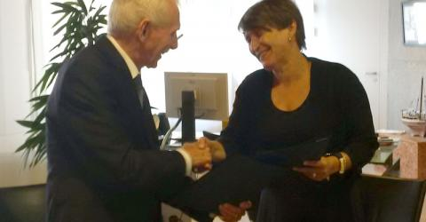 IOM Director General William Lacy Swing and Minister Lilianne Ploumen of Netherland's Foreign Trade and Development Cooperation after signing the Memorandum for future cooperation towards a more comprehensive and long-term approach to migration governance. Photo: IOM