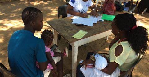 A couple registers their children and also tests for HIV during the Healthy Holidays campaign in Mozambique