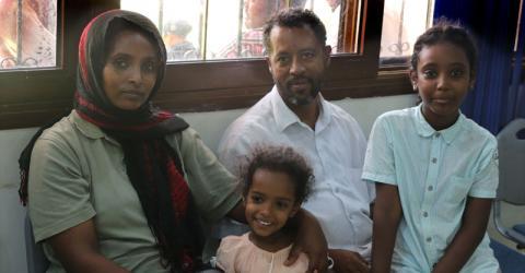 An Eritrean refugee family en route to Canada. Photo: IOM