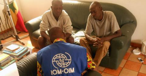 IOM staff assist stranded Senegalese migrants return home from Gabon.