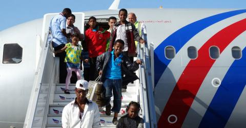 Somalis arrive at Aden Abdulle International Airport in Mogadishu, Somalia on 18 May after they were evacuated from Yemen by IOM and the Federal Government of Somalia. © IOM/Hamza Osman 2015