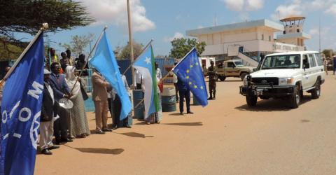 IOM, Somalia immigration officials and EU representatives flag off vehicles donated to the Immigration department in Kismayo, Somalia during a launch of EU funded project that aims at addressing root causes of irregular migration and displaced persons in Africa. Photo: IOM / Mohamed Bare