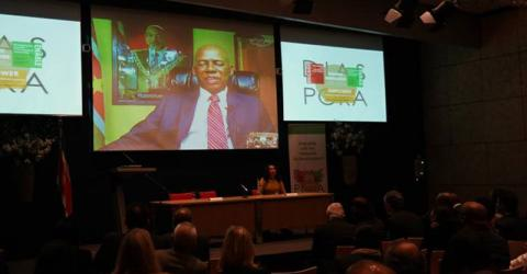 Suriname Minister of Foreign Affairs Winston Lackin speaks via Skype at a seminar in The Hague on 7th February during the launch of an appeal by Suriname to engage its worldwide diaspora community. © IOM 2015