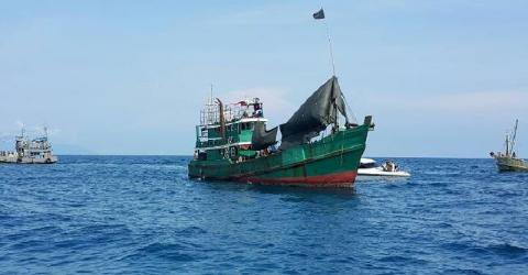 An abandoned boat used for carrying migrants from Myanmar and Bangladesh off the coast of Thailand's Satun province. Photo: Royal Thai Navy, May 2015