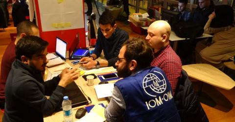 Hackathon participants brainstorm on how to help refugees in Turkey. Photo: IOM
