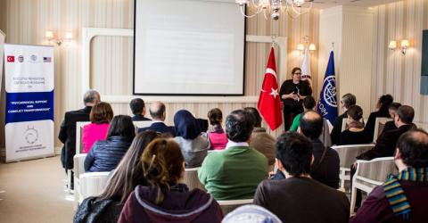 Turkish and Syrian NGO workers learn how to help refugees cope with psychosocial issues. Photo: IOM