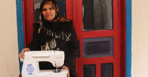 Wahda, who worked as a professional tailor in Syria, received a tailoring toolkit to start her own business. Photo: IOM
