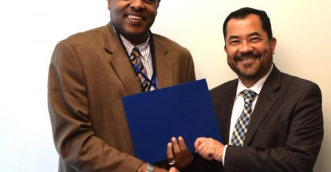 Ashraf El Nour, Director of IOM NY, and Mario Tuason, Chief, Capacity Development Office of UN DESA at the signing of the new contribution agreement. Photo: UN Migration Agency/Abdirahman Olow