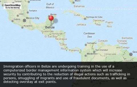 Belizean immigration officials study the use of computerized  border management information systems. © IOM 2013