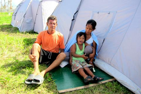 Charlie and his wife and son live in ESSU Tent City, a camp managed by IOM.  © IOM 2013 (Photo by Andrew Lind)