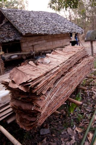 """The """"planks"""" made from banana leaves used for wall material that Tzing and his family sell. This stack sells for about USD1.50.  © Mikel Flamm 2013"""