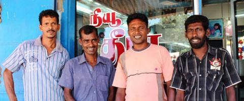 Edward Roshan (second from  left) with his business partners at Theela Salon, just outside Killinochchi  © Joe Lowry 2013