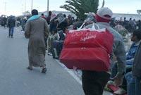 Egyptian migrants at Djerba airport. © IOM 2011