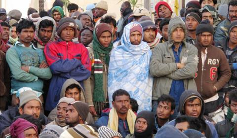 Bangladeshi migrant workers who fled the conflict in Libya are assisted by IOM. The Organization on March 8 helped some 2,180 Bangladeshi migrant workers return home. © IOM 2011 (Photo: Chris Lom)