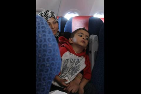 The first flight of refugees to Germany included 30 men, 40 women, 34 children and 3 infants. © IOM 2013 (Photo by Samantha Donkin)
