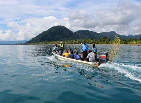 An IOM team en route to the remote village of Labu Tale, Northern Papua New Guinea where the Organization runs a Community-Based Disaster Risk Management Programme. © IOM 2014 (Photo by Joe Lowry)
