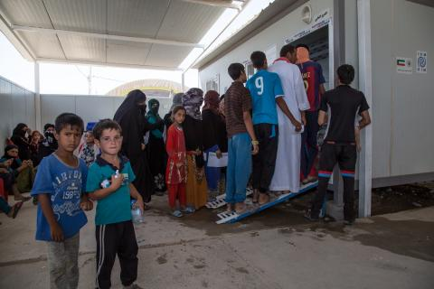 Displaced Iraqis, among them recently displaced from Talafar - the last major ISIL stronghold in Iraq - are waiting their turns to be seen by doctors at IOM's health center at Haj Ali emergency site, south of Mosul.
