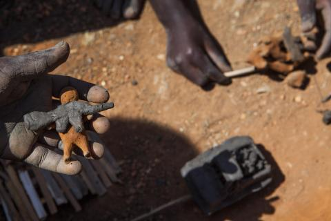Children use mud to make toys, often depicting what they witnessed before arriving at the site. UN PoC Site, Bentiu. Photo: IOM/Bannon 2015