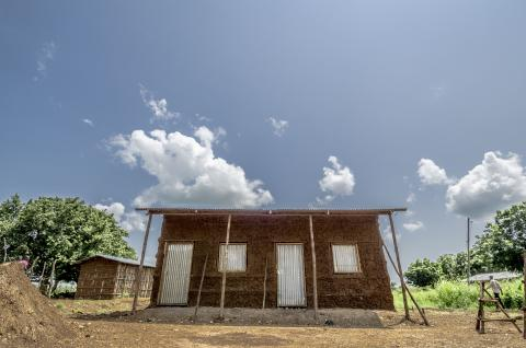 Transitional shelter (mud house) for host community in Itang, Gambella.
