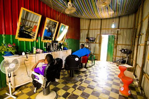 Abdi Fatah Abdi, host community member and livelihood beneficiary practicing his trade as a barber in his shop in Dollo Ado, Somali Region, Ethiopia. Photo: Rikka Tupaz / UN Migration Agency (IOM) 2017