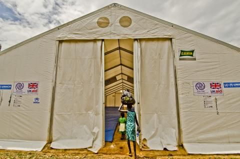 South Sudanese refugee enters tent (accommodation) at Gimbi way station. Day two of three-day convoy of South Sudanese refugees from Pagak Reception Center, Gambella Region to Gure-Shembola in Assosa Region.