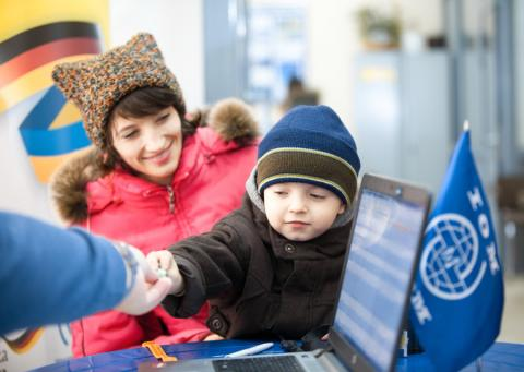 Displaced family in Kharkiv, Ukraine, receiving cash assistance from IOM within a project, funded by Germany. Photos: © IOM / Alexander Rozhenyuk