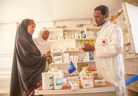 A beneficiary receives a prescription from one of the Japan funded health clinics in Puntland, Somalia. File photo: IOM / Mary- Sanyu Osire
