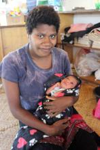 Baby Pamela Ialoo with her mother Katelina.  © IOM/Joe Lowry 2015
