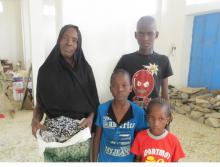 Amina and her young family. © IOM 2015