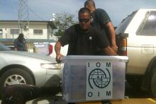 IOM Micronesia staff prepare provisions for delivery to a tanker stranded on a reef near the capital Pohnpei. © IOM 2014