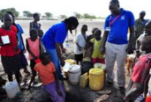 IOM staff distributes chlorine water treatment tablets and medicines for common health conditions in Turkana, Kenya. © IOM 2012