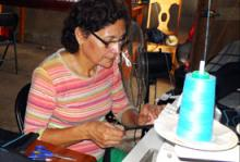 Socorro Morales, a 54-year-old Nicaraguan returnee works on her sewing machine which was part of the assistance given to her by IOM. The Assisted Voluntary Return Programme (AVRR), a Swiss-funded programme provided 3,000 Swiss Francs for each returnee to set up a business or return to school. © IOM 2012